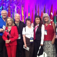"<p style=""text-align: center;"">Yan's fan club on stage at the International Conference in Orlando-2012</p>"