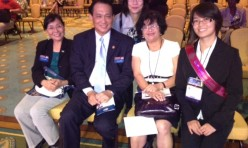 """<p style=""""text-align: center;"""">Fellow Podium Toastmaster member Janet sitting with our 2012-2013 International President John L.</p>"""