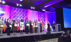 """<p style=""""text-align: center;"""">Yan up on stage with fellow contestants at the semi-finals contest at the International Conference in Orlando-2012</p>"""