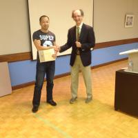 "<p style=""text-align: center;"">Bryan accepting his 2nd place Table Topics Award</p>"