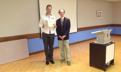 "<p style=""text-align: center;"">Derek accepting his 1st place Table Topics Award</p>"
